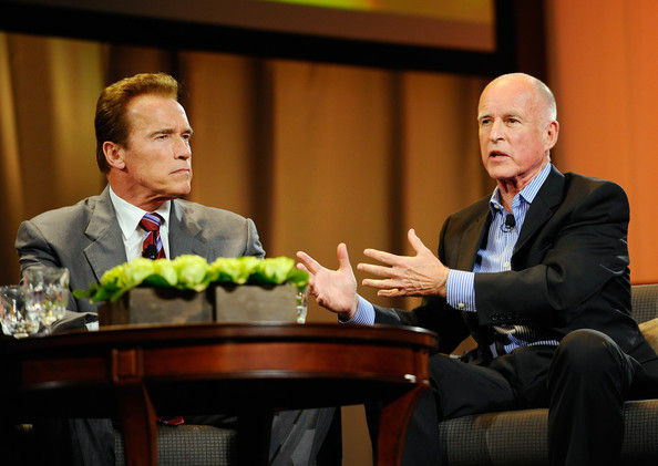 Then-Democratic candidate for governor Jerry Brown (R) speaks as then-California Gov. Arnold Schwarzenegger (L) looks on during a discussion moderated by 'Today' show host Matt Lauer during the Women's Conference 2010 on October 26, 2010 at the Long Beach Convention Center in Long Beach, California.