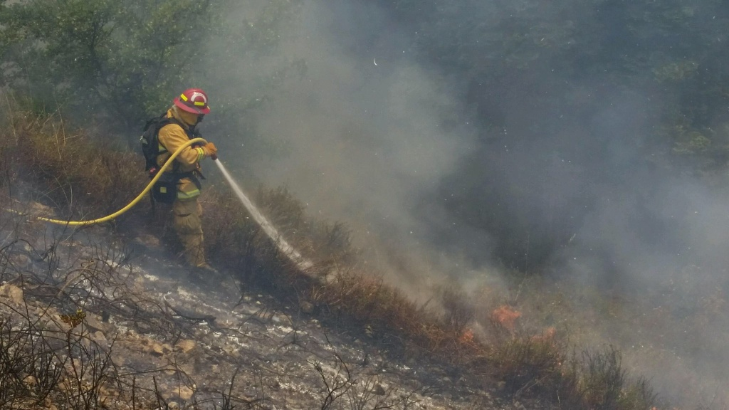 A firefighter from the Palo Alto and Santa Clarita County strike team works on the Soberanes Fire on Tuesday, July 26, 2016.