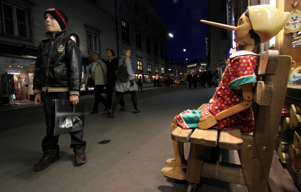 A large wooden Pinocchio puppet attracts customers into a shop selling wooden art in the city centre of Vienna on November 28, 2009.