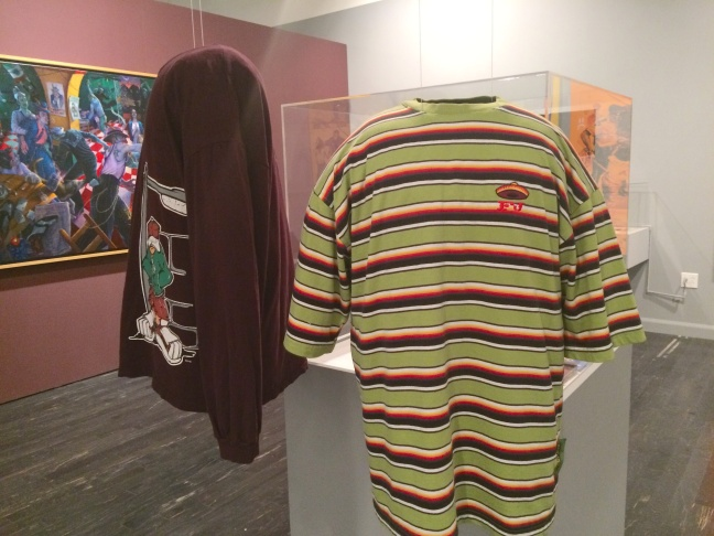 An installation of zoot suits from the 1940s, by John Carlos de Luna (aka Barrio Dandy).