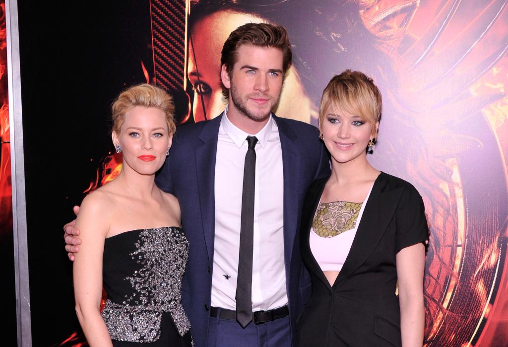 Elizabeth Banks, Liam Hemsworth, and Jennifer Lawrence attend the