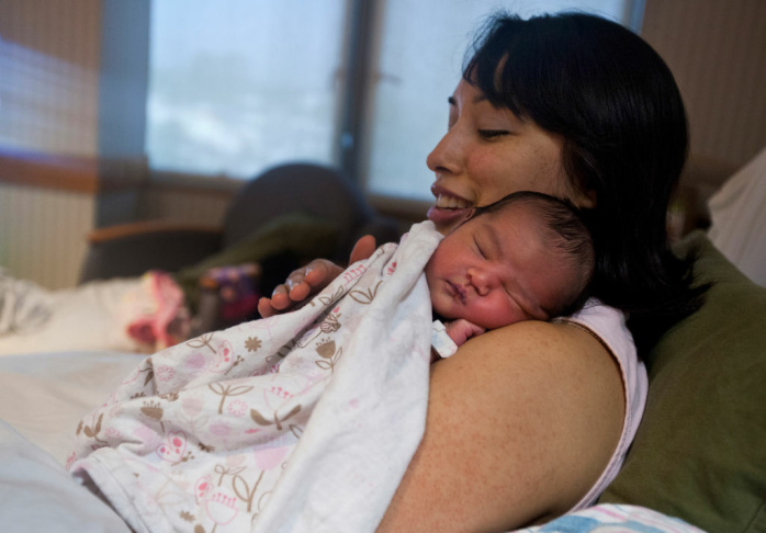 Lani of Hermosa Beach holds her 2-day-old daughter Adriana on Monday, Feb. 4 at Providence Little Company of Mary Medical Center in San Pedro. Lani said she looked at four hospitals before deciding on where to give birth.