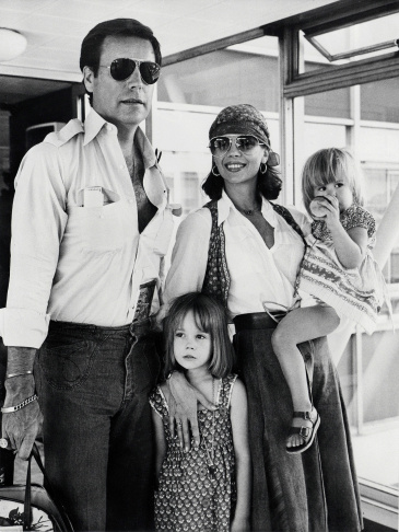 American actress Natalie Wood (1938-1981), her children Natasha (C), Courtney (R), and her husband U.S. actor Robert Wagner arrive at London airport July 4, 1976