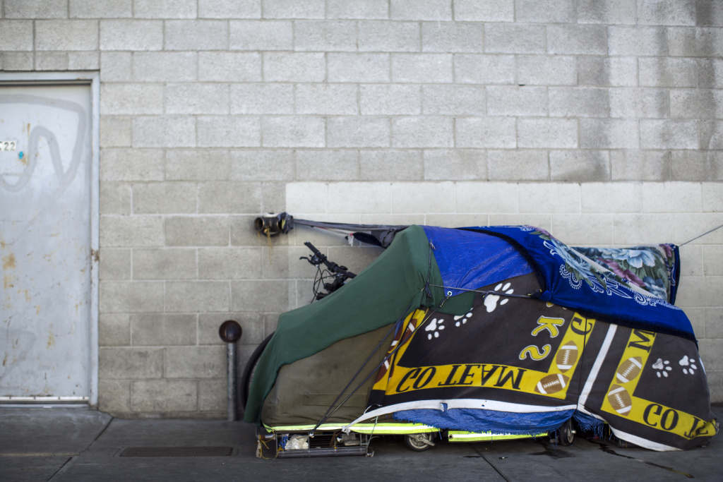 A tent stands on E Fifth Street at Towne Avenue in Skid Row on Thursday morning, Dec. 17, 2015 near where General Dogon used to live.