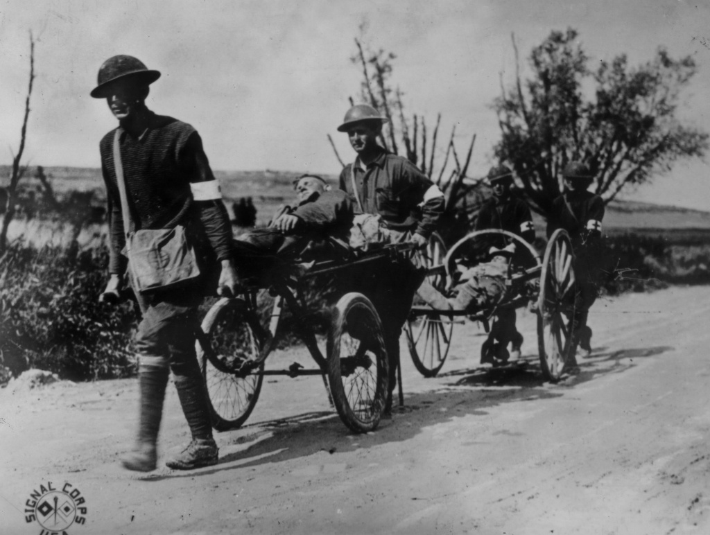 Wounded American soldiers being carried on wheel litters in the Argonne region of France.