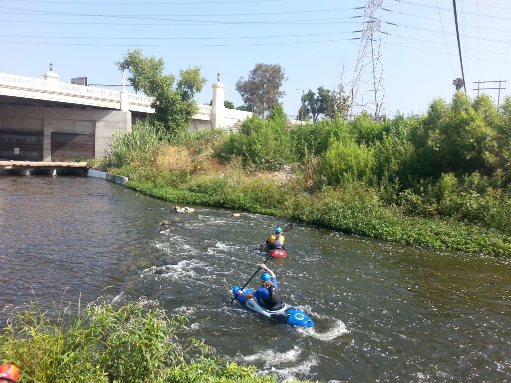 Advanced whitewater boaters from the L.A. Kayak Club take on the L.A. River one hot summer Sunday.