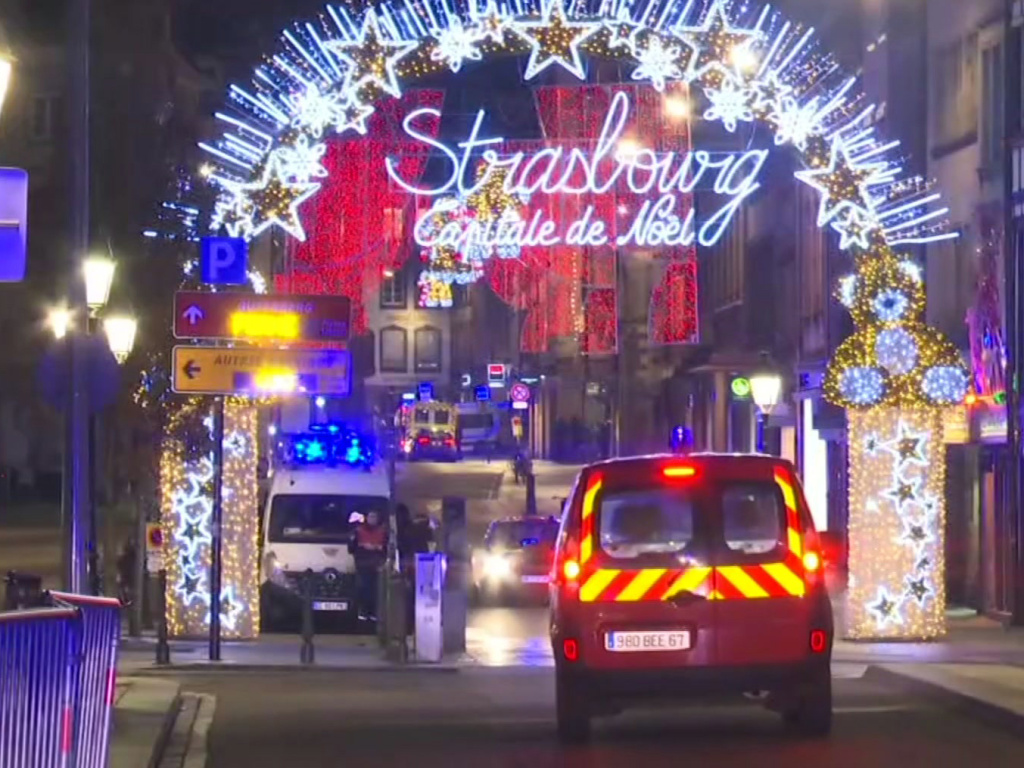 French emergency services arrive at a Christmas market in Strasbourg, France, after a gunman killed at least two people and wounded several more.