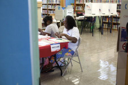 Poll workers await voters at Angeles Mesa Elementary school during a special run-off election for the Los Angeles Unified School District board of education seat in District 1.