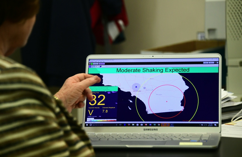 Margaret Vinci, manager of the Seismological Laboratory at California Institute of Technology (Caltech) points to a shake alert user display on a laptop screen, set for a limited release on June 1, 2017 at the Caltech Seismological Laboratory in Pasadena, California, where they addressed the elimination of federal funding for the West Coast Earthquake early Warning system, also known as ShakeAlert, in President Trump's FY2018 budget. / AFP PHOTO / FREDERIC J. BROWN        (Photo credit should read FREDERIC J. BROWN/AFP/Getty Images)