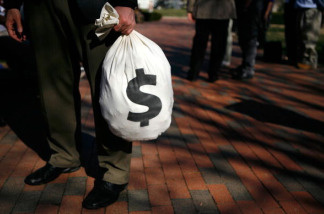 WASHINGTON - MARCH 09: A man carries a props money bag during a rally at the Lafayette Square March 9, 2009 in Washington, DC.