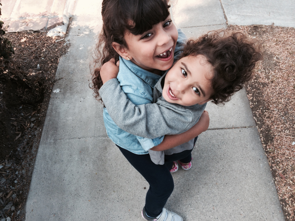 FILE: Dina Khalil's youngest daughters are enrolled in Shenandoah Elementary's Family Literacy program and state preschool. Khalil felt like an outsider at the school until she was welcomed into the Family Literacy classroom.