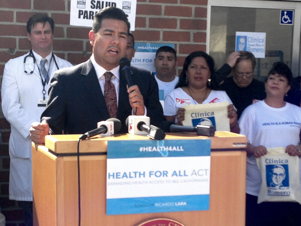 State Sen. Ricardo Lara (D-Long Beach) introducing SB 1005 at a news conference outside Clinica Oscar Romero in Boyle Heights.