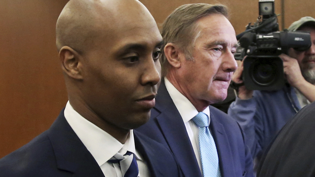 Mohamed Noor (left), a former Minneapolis police officer, leaves the Hennepin County Government Center in Minneapolis with attorney Peter Wold last month. Noor has been found guilty of shooting an unarmed civilian to death in 2017.