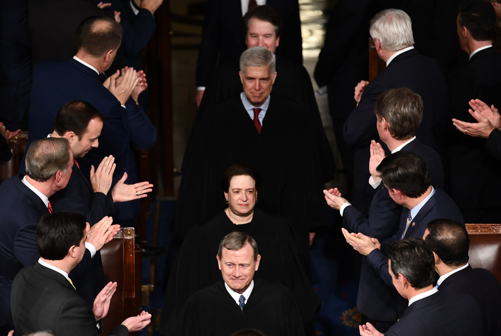 US Supreme Court Chief Justice John Roberts, US Supreme Court Justice Elena Kagan, US Supreme Court Justice Neil Gorsuch arrive for the State of the Union address at the US Capitol in Washington, DC, on February 4, 2020.