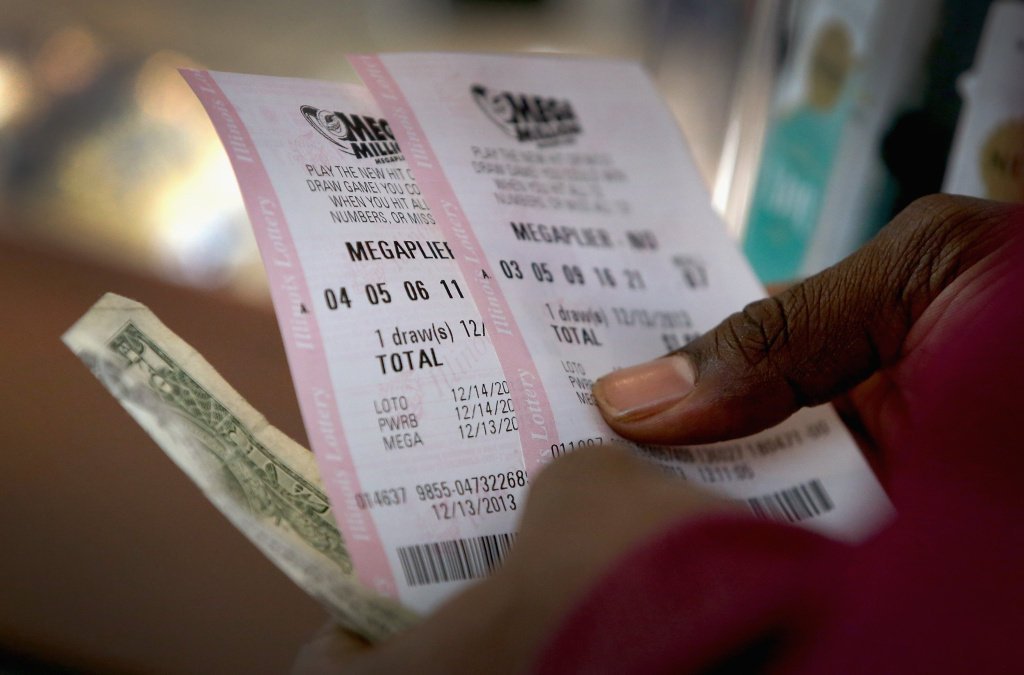 A customer buys Mega Millions lottery tickets at a 7-Eleven store on Friday in Chicago, Illinois.