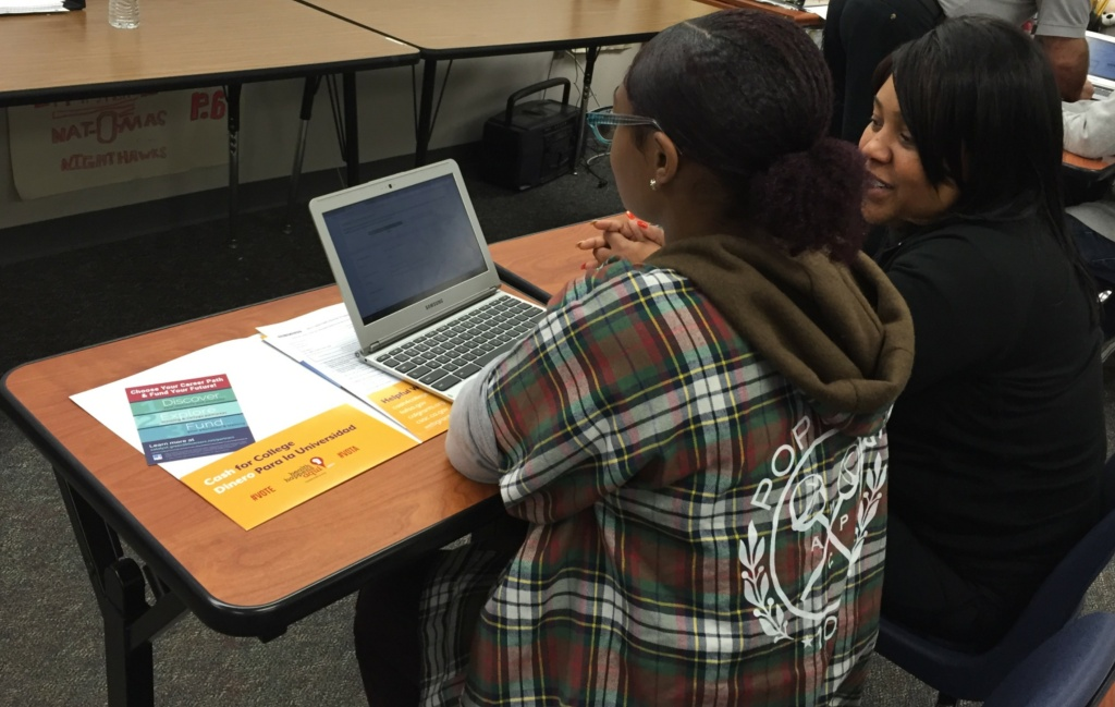 A student in the Sacramento area gets help filling out the federal financial application.