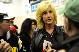 Advocate Erin Brockovich meets with Hinkley, Calif., residents during the Lahontan Regional Water Quality Control Board presentation earlier this month.