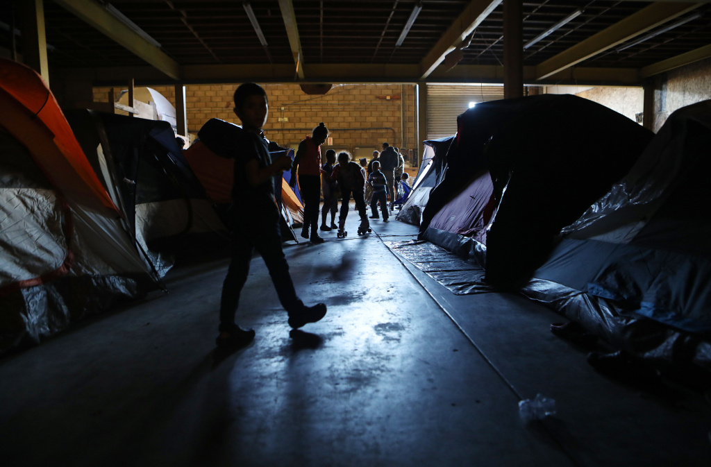 Migrants gather in the third shelter opened to migrants in Tijuana weeks after thousands from the 'migrant caravan' arrived in the border city on December 16, 2018 in Tijuana, Mexico.