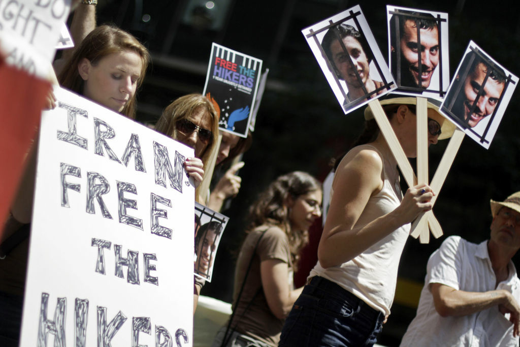 Lauren Wendle of Tarrytown, New York, observes a moment of reflection, during a demonstration against the detainment of three U.S. Citizens being held in Iran outside the Iranian mission to the United Nations on July, 30, 2010 in New York City.  Josh Fattal, Shane Bauer, and Sarah Shourd, have been held by Irainian authorities since July 31, 2009 after they were detained along the Iraq and Iran border and accused of spying.   (
