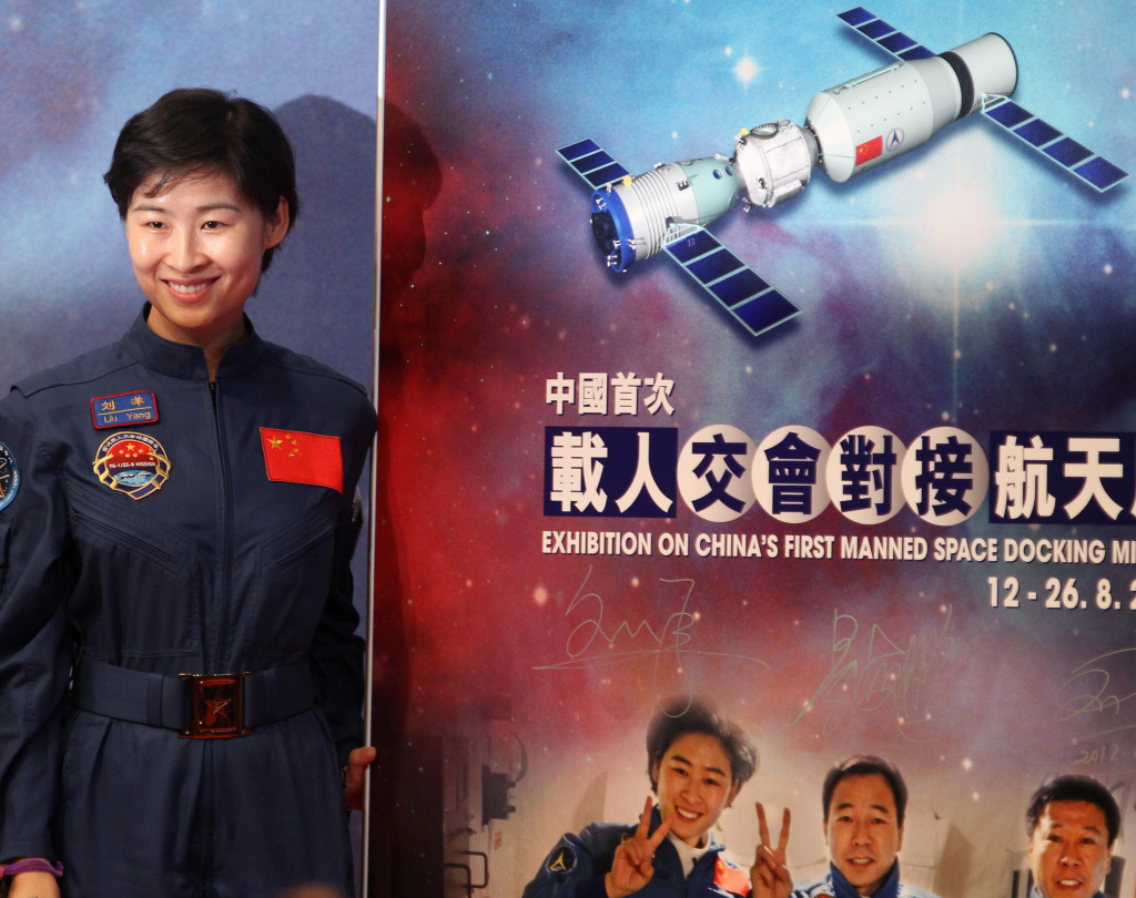 Chinese astronaut Liu Yang of the Tiangong-1/Shenzhou-9 Manned Space Docking and Rendezvous Mission delegation poses for photographs during the opening ceremony of an exhibition on China's first manned space docking mission in Hong Kong on August 12, 2012.