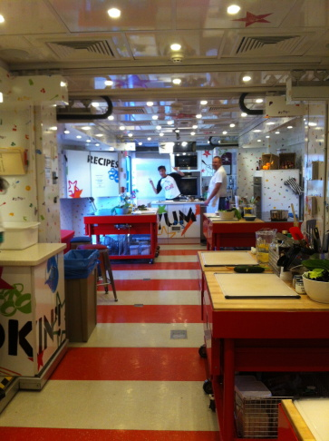 Kids cooking at one of four mini-stations.