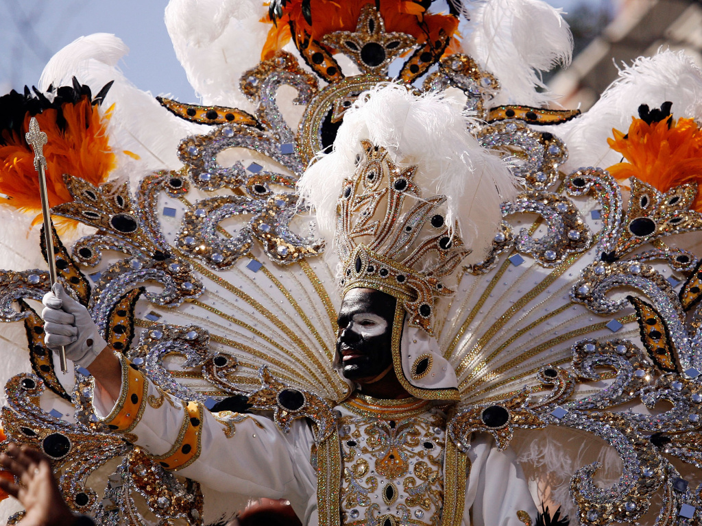 King Zulu waves to the crowds from his float on Mardi Gras day on Feb. 24, 2009 in New Orleans. The Zulu Social Aid & Pleasure Club is facing criticism for its tradition of wearing black face makeup during Mardi Gras.