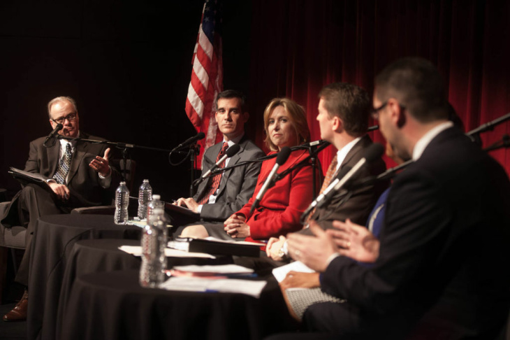 Larry Mantle moderates a debate between mayoral canidates (from right) Emanuel Pleitez, Jan Perry, Kevin James, Wendy Grueul and Eric Garcetti at KPCC's Crawford Family Forum on February 5, 2013.