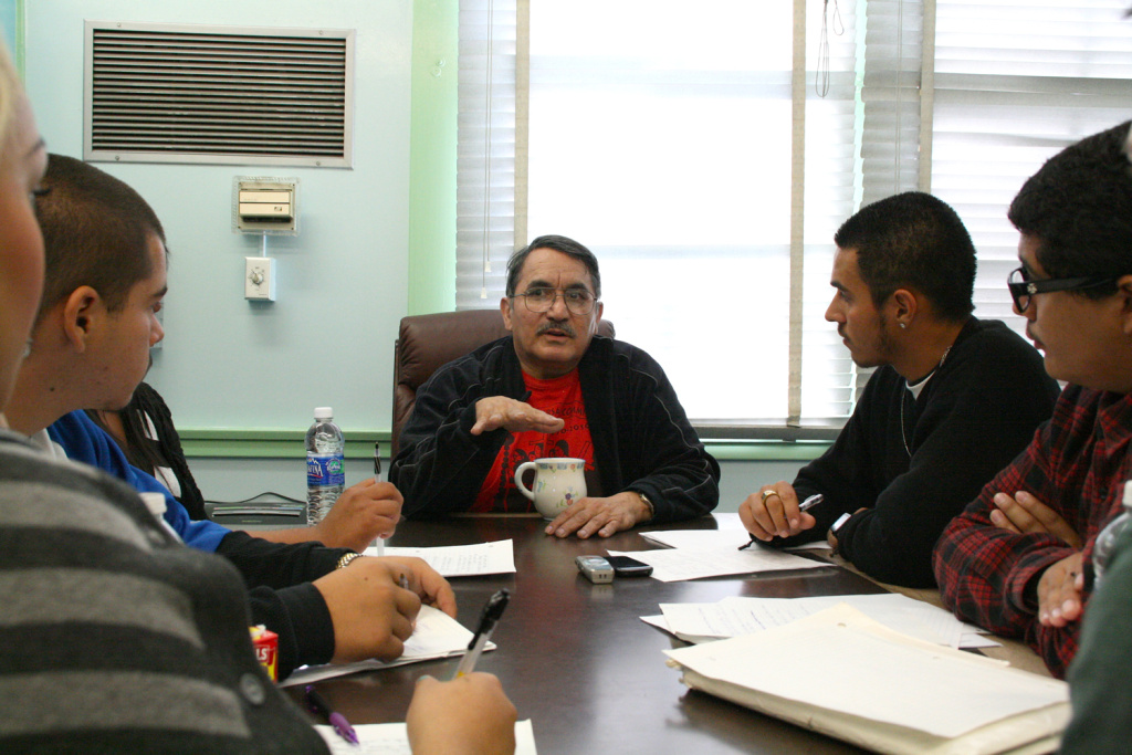 Rosalio Muñoz (center), who participated as an organizer in the 1970s Chicano Moratorium is interviewed by Monterey Continuation High School students. Visible from left to right: Jessie Serna, 17; Oscar Lechuga, 18; and Andrew Burciaga, 18.