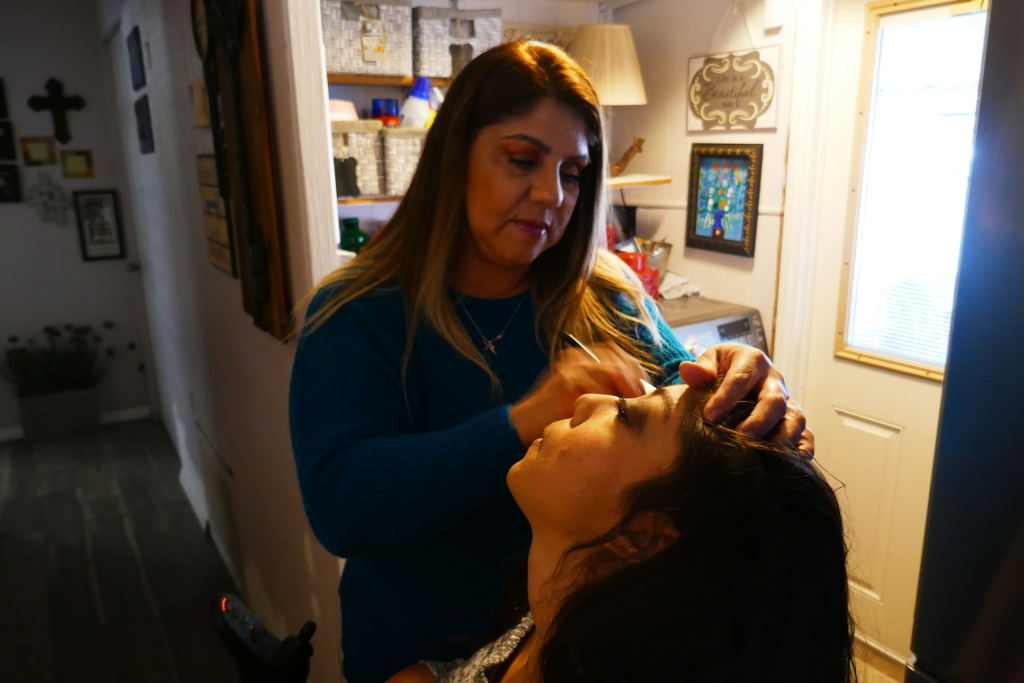 Monica Pasillas applies eye shadow to her daughter Maritza's eyelids. Maritza has cerebral palsy and sometimes need assistance with her make-up.