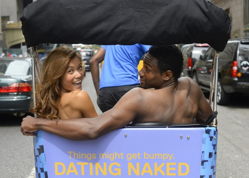 Kelly Keodara and Yarc Lewinson ride around Grand Central Station in New York on July 16, 2014 in a pedicab to promote a new VH1 series to the roster called 'Dating Naked,' which is built on the premise of stripping away the outer trappings of attraction by dating naked.