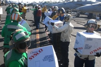 Sailors assigned to the aircraft carrier USS Ronald Reagan prepare 4,500 pounds of supplies on Nov. 9, 2010, to be delivered to the Carnival Splendor, which lost power and became stranded early Monday after a fire in the engine room. The aircraft carrier was diverted from its current training maneuvers to help out the cruise ship which was on its way to the Mexican Riviera.