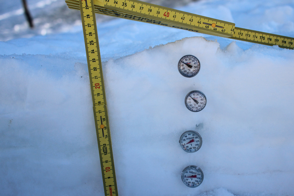 Temperature gauges often reveal different temperatures within a snowbank. The temperatures reflect the composition of the water within the bank.