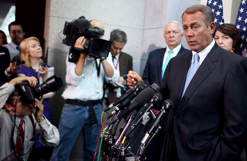 House Speaker John Boehner (R-OH) speaks to reporters during media availability at the U.S. Capitol on Nov. 30, 2011, in Washington, DC. On Thursday morning, Congress has come to a tentative agreement on a House Republican-proposed $1 trillion spending bill.
