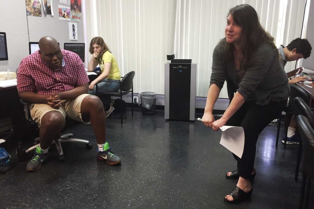 Instructor Kat Cutright gets physical, illustrating the basics concepts of animation with her body, during a summer program at Exceptional Minds.