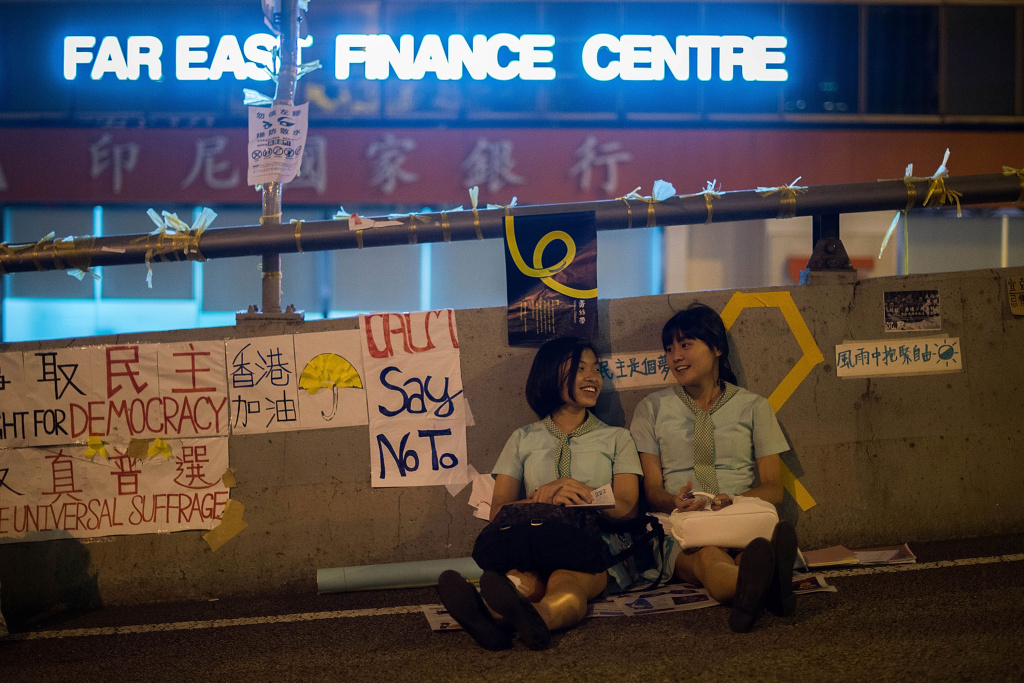 Students sit on a bridge near of Hong Kong Government Complex on October 6, 2014 in Hong Kong. Pro democracy supporters continue to occupy the streets surrounding Hong Kong's Financial district. The protesters are calling for open elections and the resignation of Hong Kong's Chief Executive Leung Chun-ying.