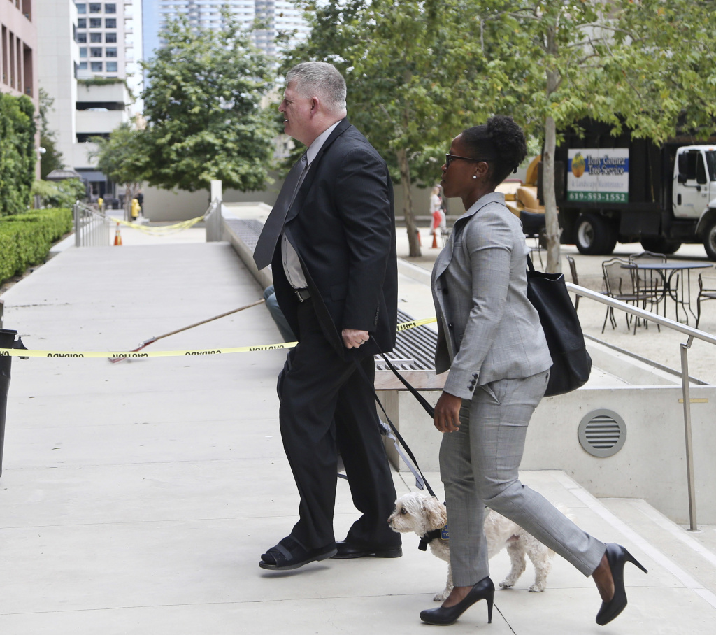 "Rear Adm. Robert Gilbeau enters the federal courthouse in San Diego on June 9, 2016. Gilbeau pleaded guilty to lying to federal authorities investigating a $34 million fraud scheme involving a Malaysian contractor known as ""Fat Leonard."""
