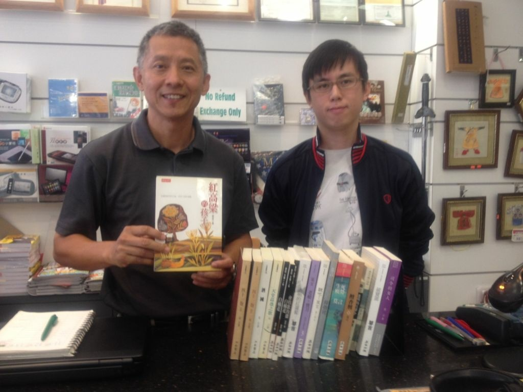 Terence Tsang and Brian Lee, managers at SUP Bookstore in Monterey Park, showcase Nobel Prize winner Mo Yan's novels.