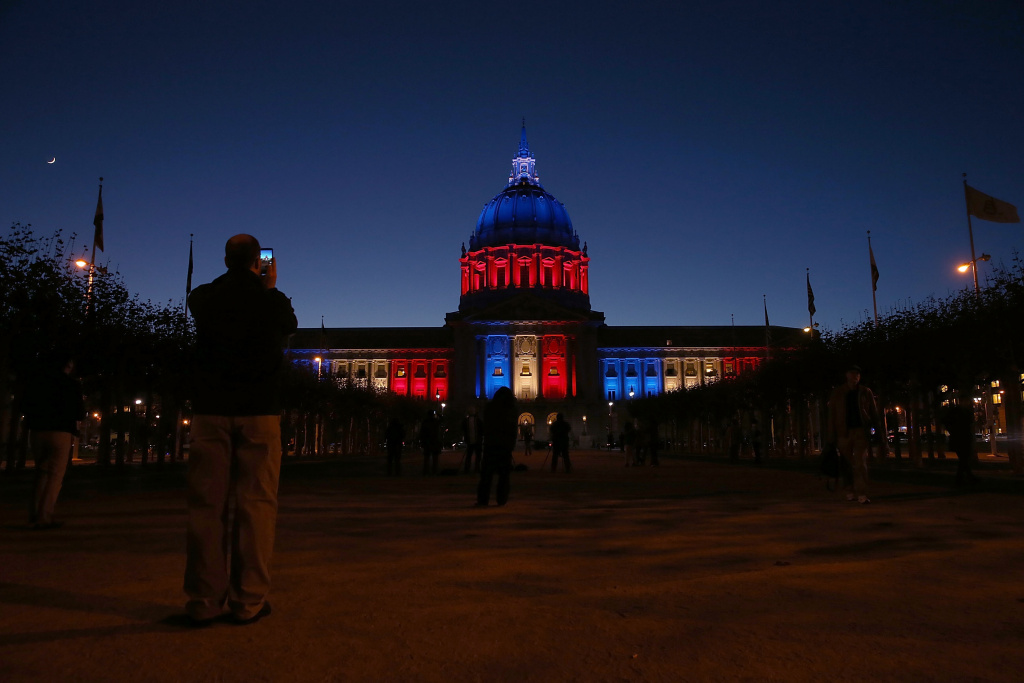San Francisco City Hall is lit up with the colors of the French flag following the terror attacks in Paris on November 14, 2015 in San Francisco, California. At least 129 people have been killed and over 300 are injured in Paris following a series of terrorist acts in the French capital on Friday.