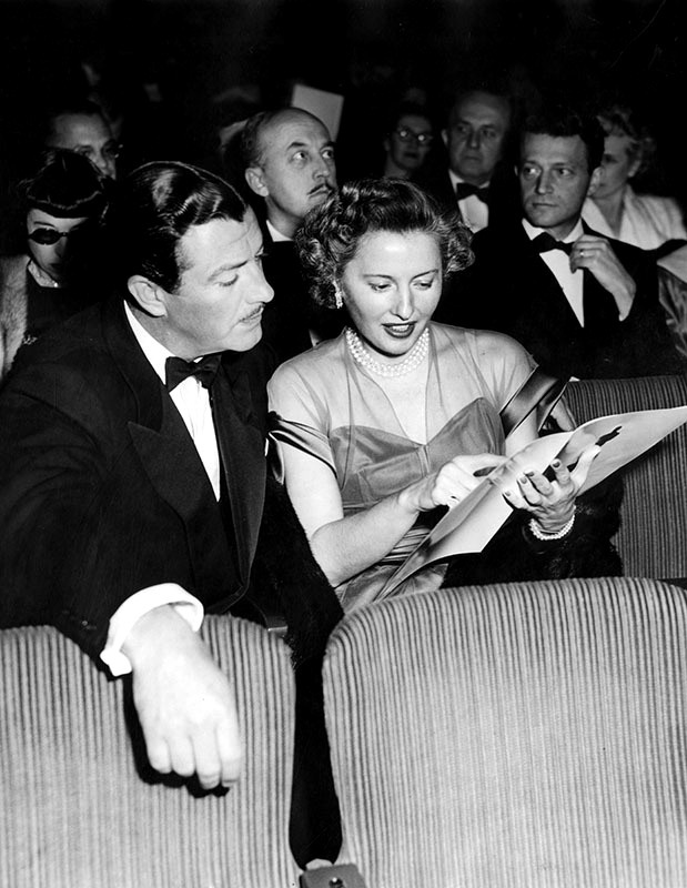 "Barbara Stanwyck with husband Robert Taylor at the 21st Academy Awards, held at the Academy Theater in Hollywood. Stanwyck was nominated for the ""Best Actress"" award for her portrayal of Leona Stevenson in the film, ""Sorry, Wrong Number,"" but she lost to Jane Wyman. Photograph March 25, 1949."