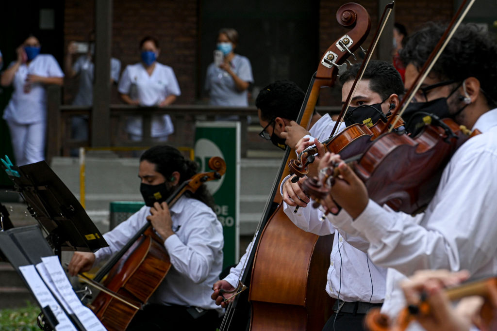 Musicians from Medellin's Philarmonic Orchestra play in front of a hospital, amid the COVID-19 pandemic, in Medellin, on August 6, 2020.