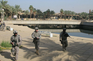 Soldiers from the 1st Brigade Combat Team of the 1st Cavalry Division walk along a plaza on Baghdad Island. Iraqi tourism officials, with the help of U.S. troops, hope to reopen part of the park in late November.