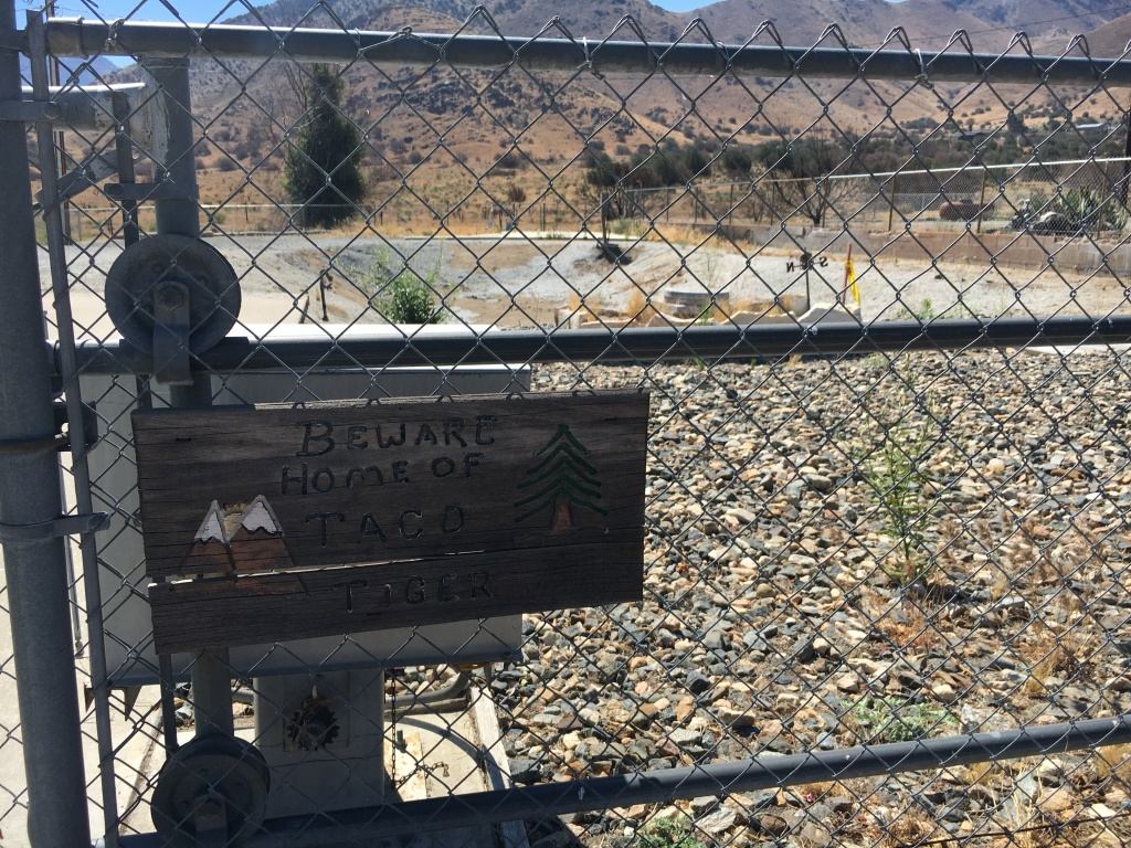 This chain link fence and a sign warning visitors to beware pets named