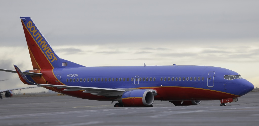 A Southwest Airlines Boeing 737 taxis to a gate in this Tuesday, Jan. 26, 2016 file photo. Southwest canceled more than 250 flights on Friday morning, mostly because of displaced crews and aircraft following a network outage earlier in the week, according to a company spokesperson.