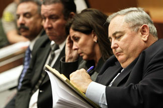From left, former Bell Mayor Oscar Hernandez, former councilman  Luis Artiga, former Assistant City Administrator Angela Spaccia and former Bell City Administrator Robert Rizzo at a 2011 preliminary hearing. Spaccia and Rizzo will stand trial after the
