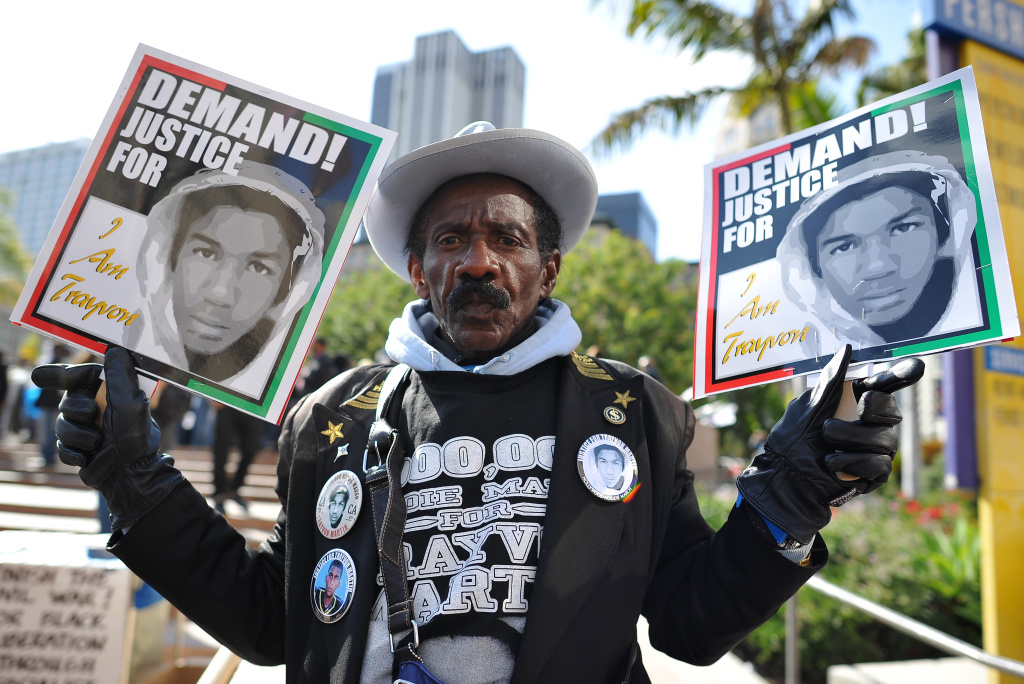 A man joins nationwide protests in memory of slain Florida teenager Trayvon Martin on March 26, 2012 in downtown of Los Angeles, California.