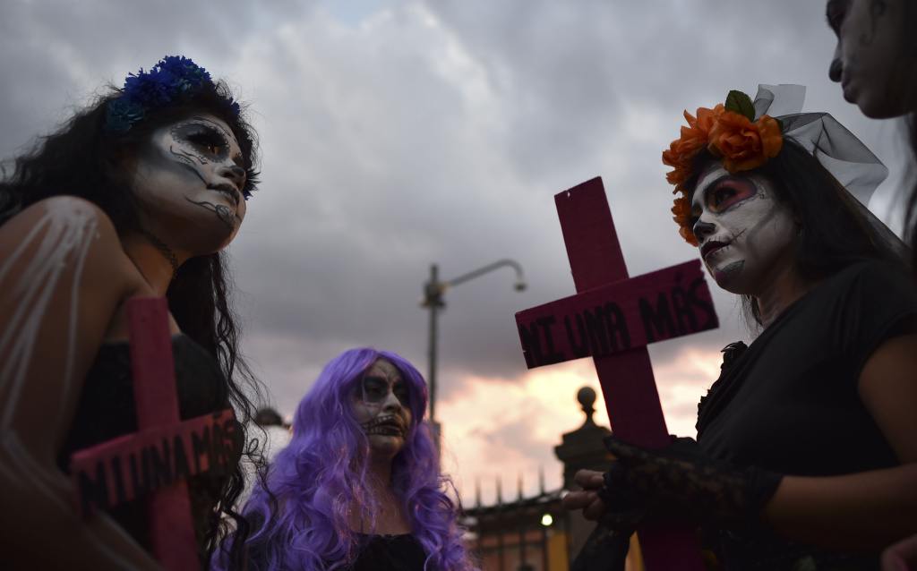 Women with crosses protest against femicides in Mexico City on November 1, 2016.