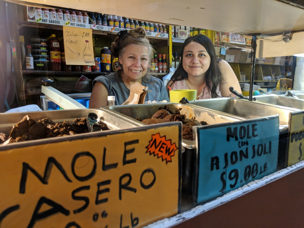Claudia Armendariz (R) runs Chiles Secos in Grand Central Market. Her late-grandfather opened it in 1975, and her whole family has taken part in the operations including Armendariz's aunt Rocio Lopez (L)