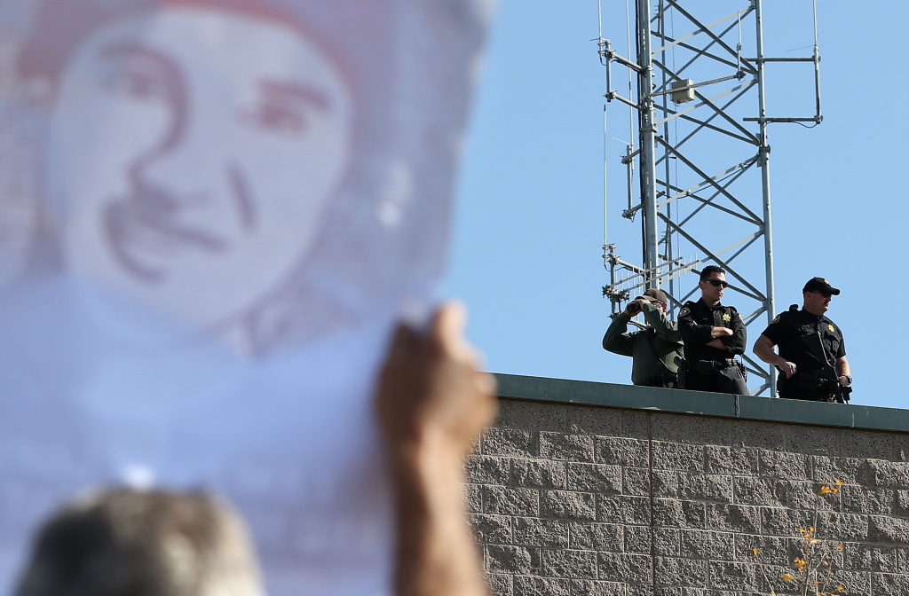 Police officers monitor protestors during a rally in front of the Sonoma County sheriff's office for 13 year-old Andy Lopez who was shot by a Sonoma County sheriff's deputy on October 29, 2013 in Santa Rosa, California. Officials in Sonoma county suggested creating a new independent auditor's office that would oversee the sheriff's department in the wake of the shooting.