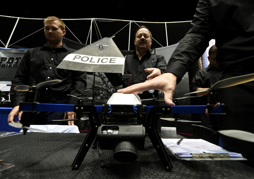Consultants from Flyspan Solutions demonstrate a drone intending for police use during the first-ever Drone Expo in Los Angeles on December 13, 2014.