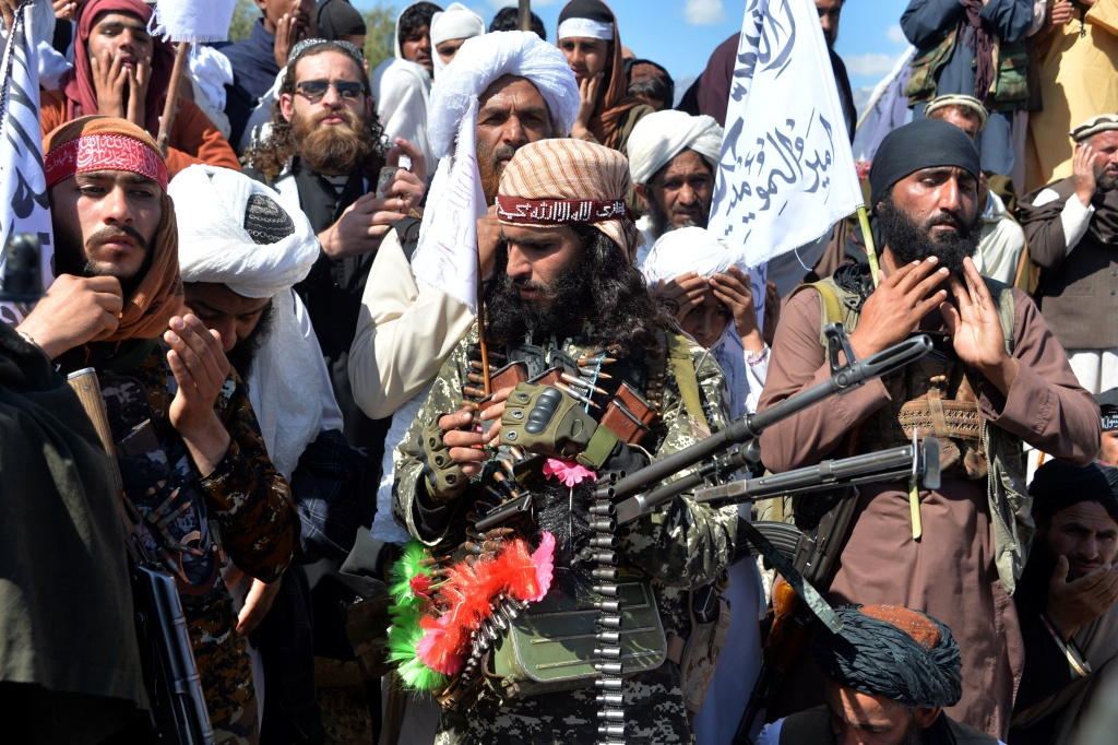 Afghan Taliban militants and villagers celebrate a peace deal and victory in March. News reports allege Russia offered bounties to Taliban-linked militants to kill U.S. troops. Russia accuses U.S. intelligence of leaking the story to scuttle the peace process.